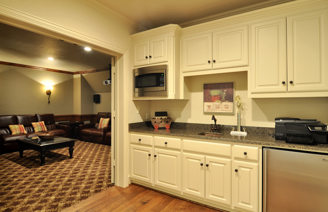 Located Just Outside The Media Room, This Wet Bar Is More Of A Kitchenette.  It Features Granite Countertops, A Small Refrigerator, Copper Sink, And  Built In ...